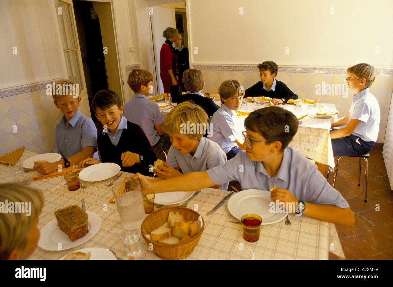 Toulouse, France: Cothill school boys having their breakfast.  The private prep school has an annex at Saveterre Chateau. - Stock Image