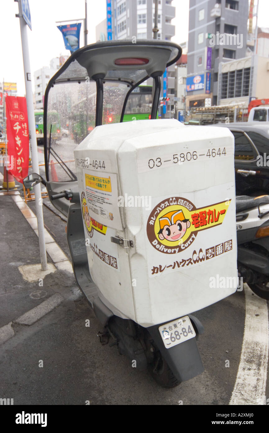 tokyo japan motor bike delivery service for curry stock photo