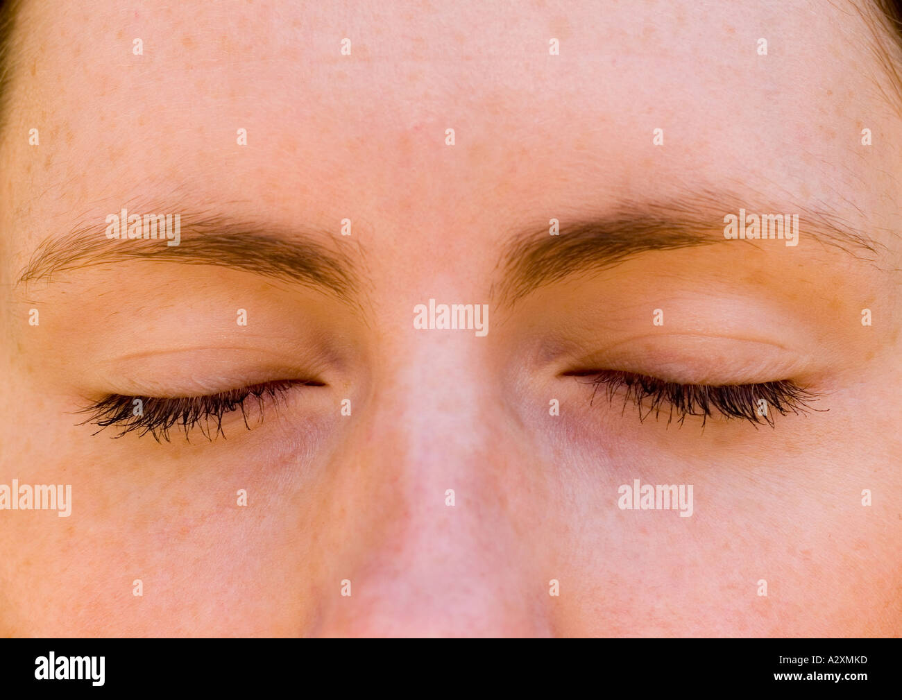 Young woman with eyes closed in thought or meditation - Stock Image