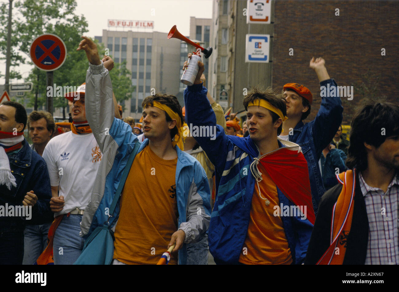 A Crowd Of Young Dutch Football Fans Cheering And Blowing Air Horns