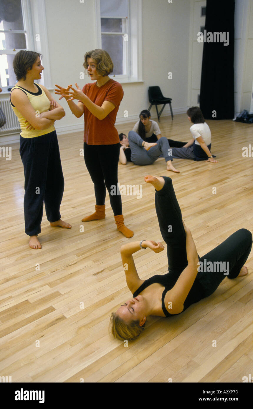 Student discussing moves while talking a break in a class at Liverpool Institute Of Performing Arts - Stock Image