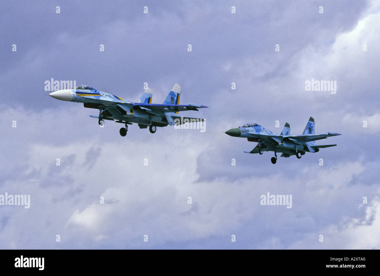 Formation flight with landing gears down Ukraine Air Force Sukhoi Su-27 Flanker - Stock Image