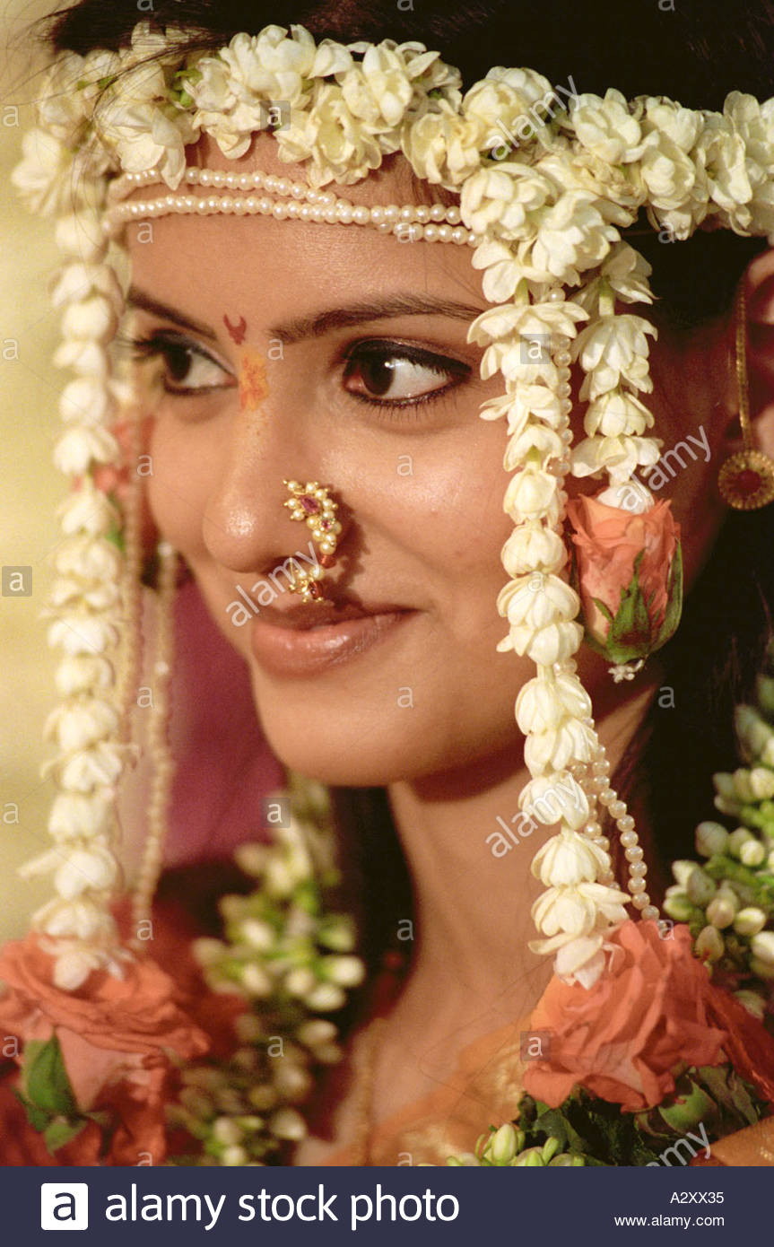 South Asian Indian wedding bride dressed in traditional makeup nose
