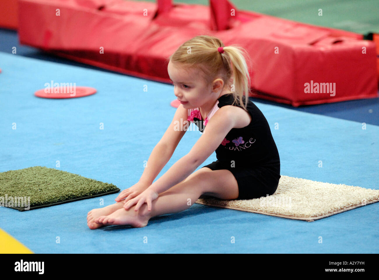 Three And Four Year Old Girls Take A Beginning Gymnastics