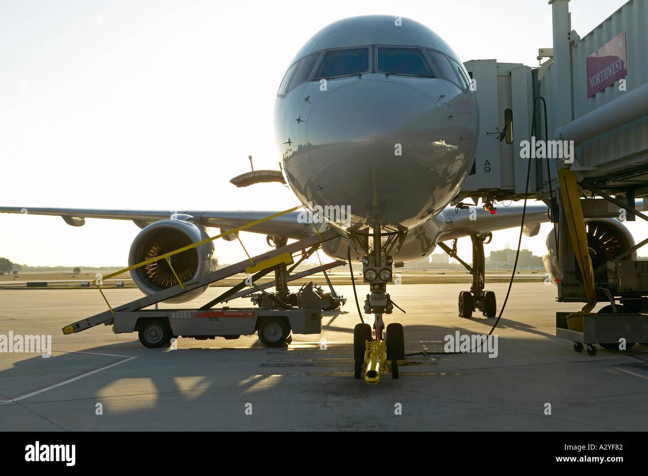 Northwest passenger jet airplane docked at airside - Stock Image