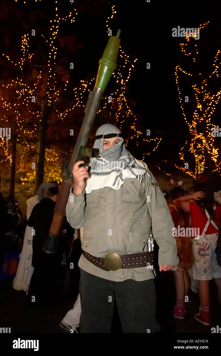 man dressed as an al qaida al qaeda terrorist with RPG rocket launcher Halloween Derry Ireland - Stock Image