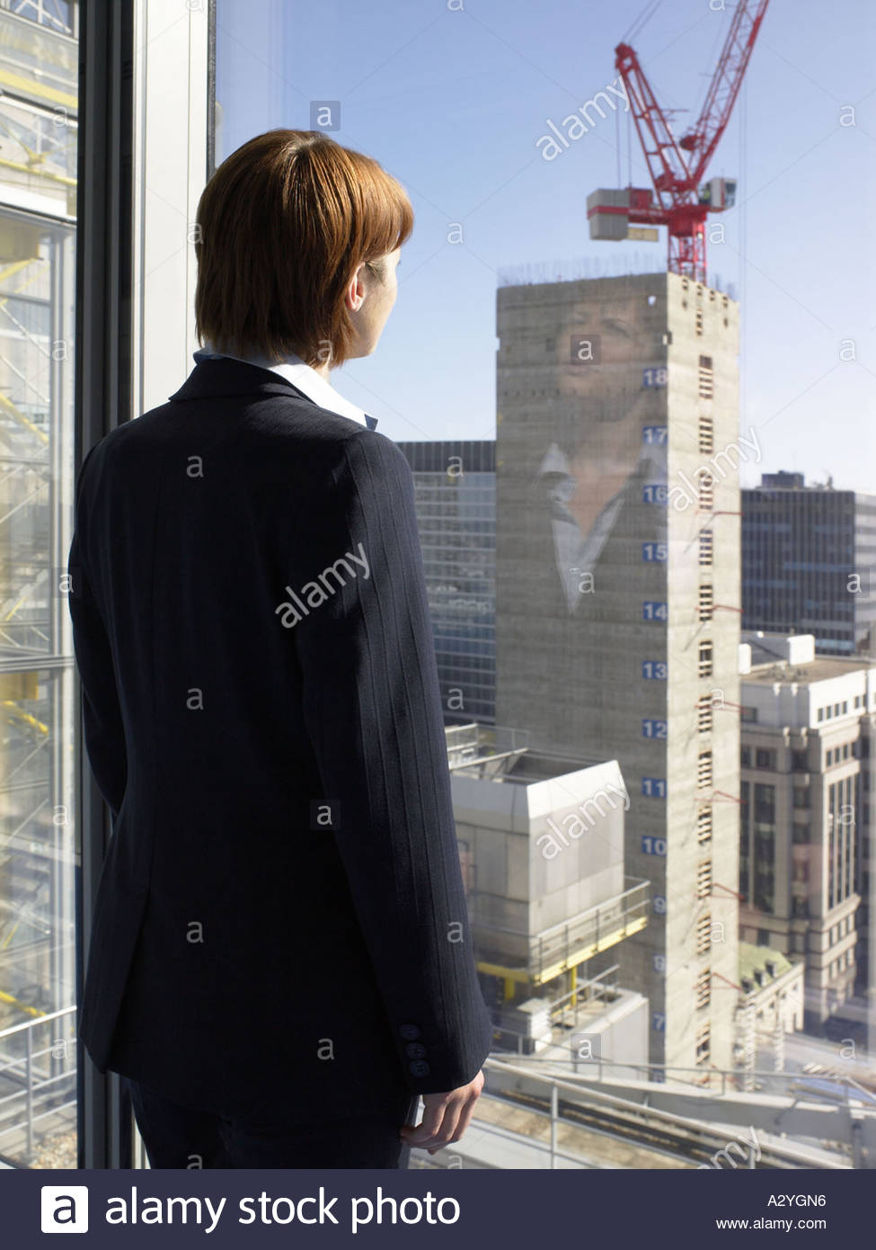 Businesswoman looking at a construction site - Stock Image