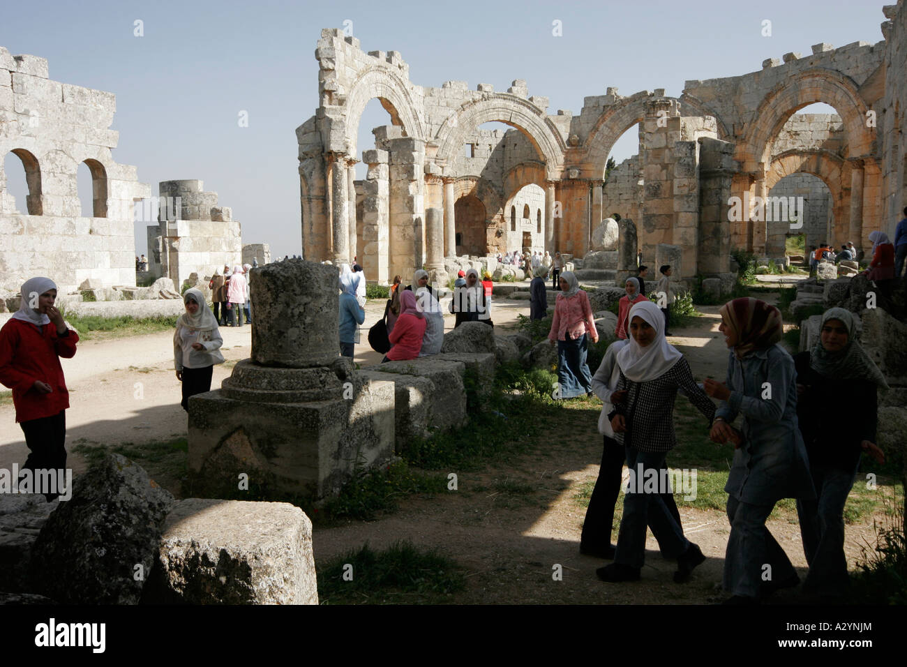 Crowd of Syrian tourists, Basilica of St Simeon, Qalaat Samaan, Syria, Middle East - Stock Image