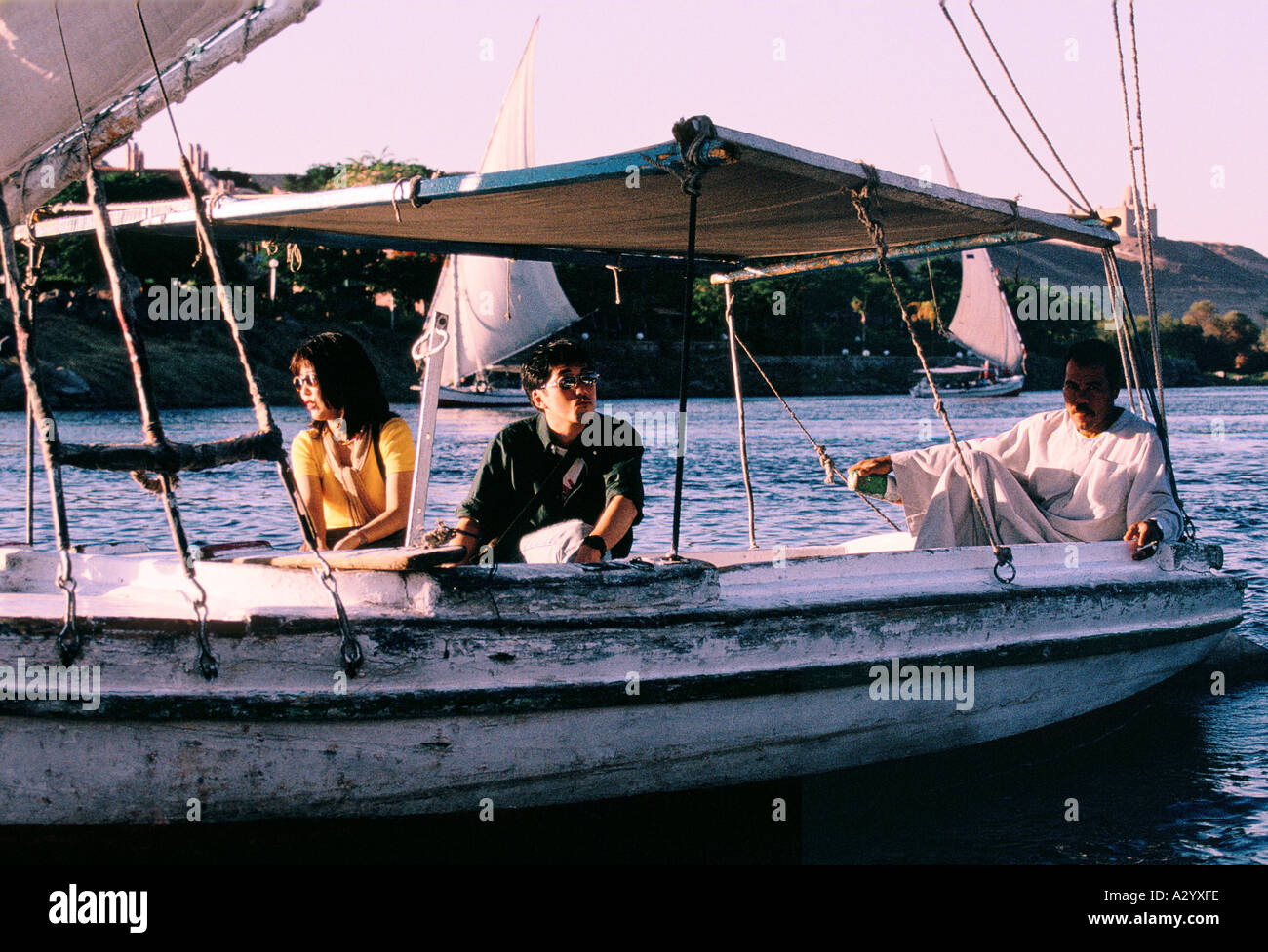 Japanese tourists taking a boat trip on the river nile at Aswan Stock Photo