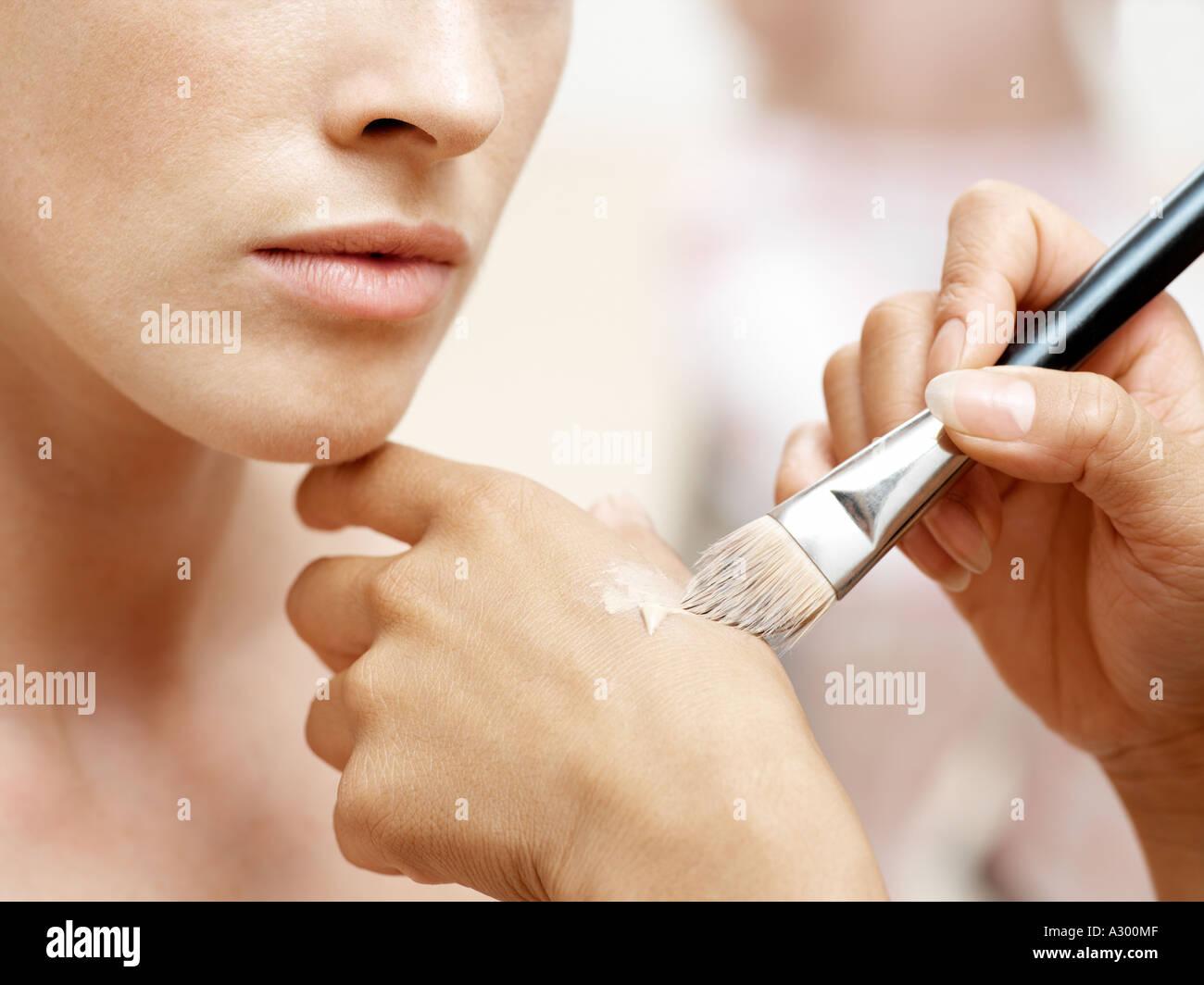 Woman having make-up done - Stock Image