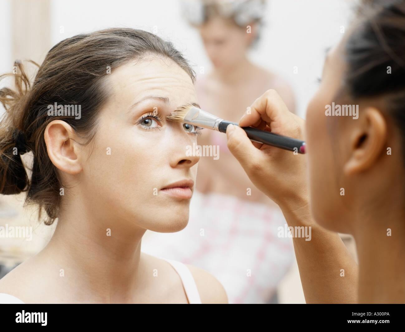 Model having make-up done - Stock Image