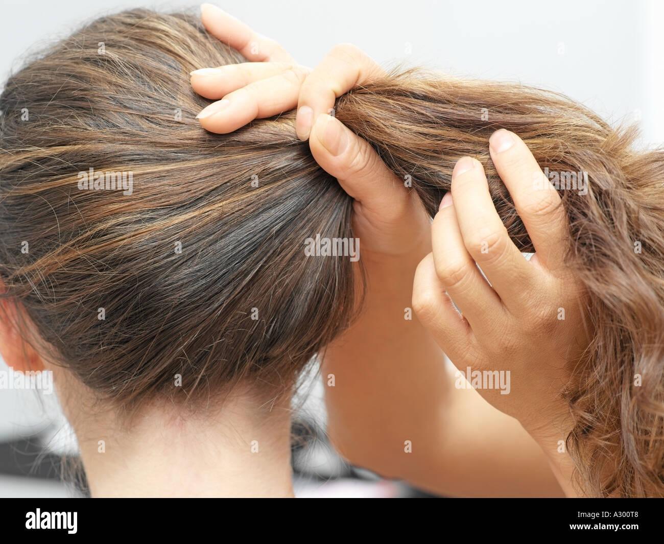 Woman having hair done - Stock Image