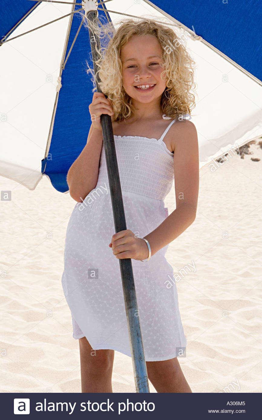 Girl with a parasol - Stock Image