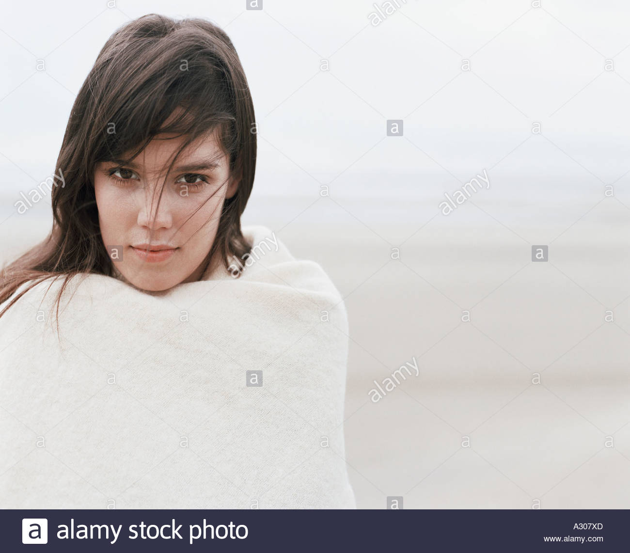 Young woman by ocean - Stock Image