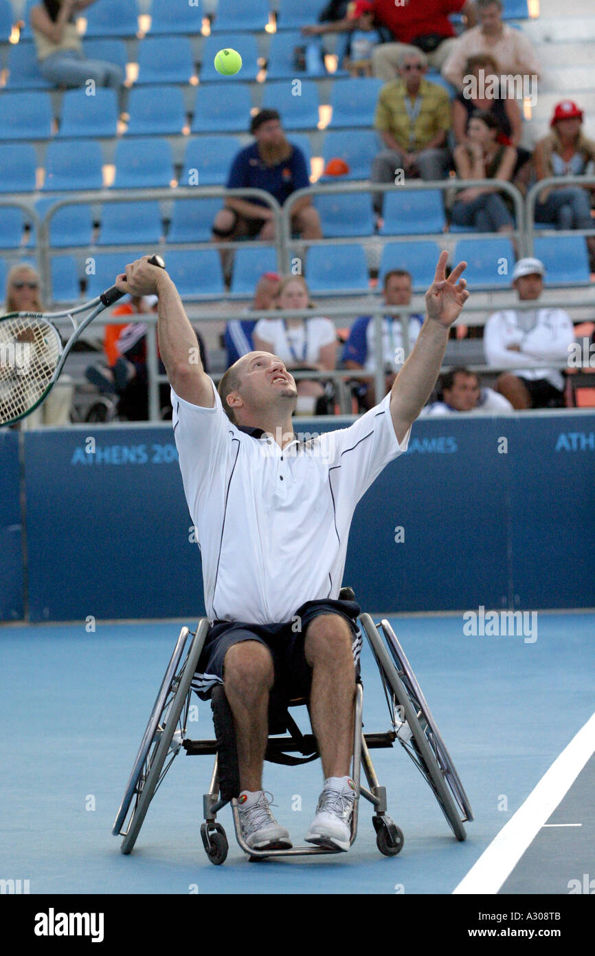 Steve Welch of The USA competes in the men's singles wheelchair tennis tournament semi finals during the Athens 2004 Paralympics - Stock Image