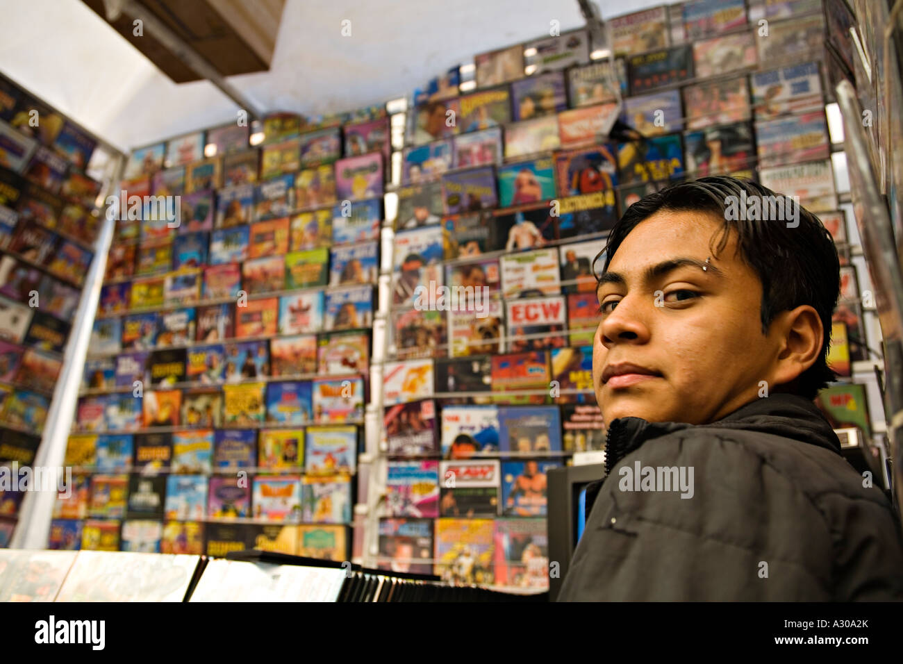 Mexico Guanajuato Young Adult Male Tend Booth Selling Dvds And Cds Pierced Eyebrow