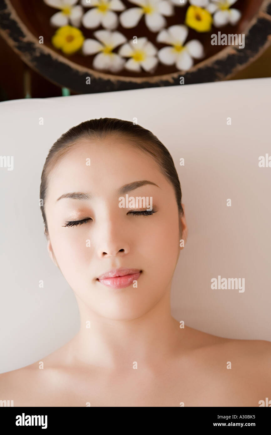 Beautiful woman with eyes closed - Stock Image
