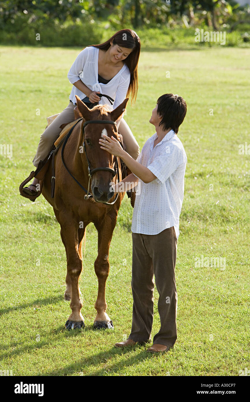 Couple Horse Riding Stock Photo Alamy