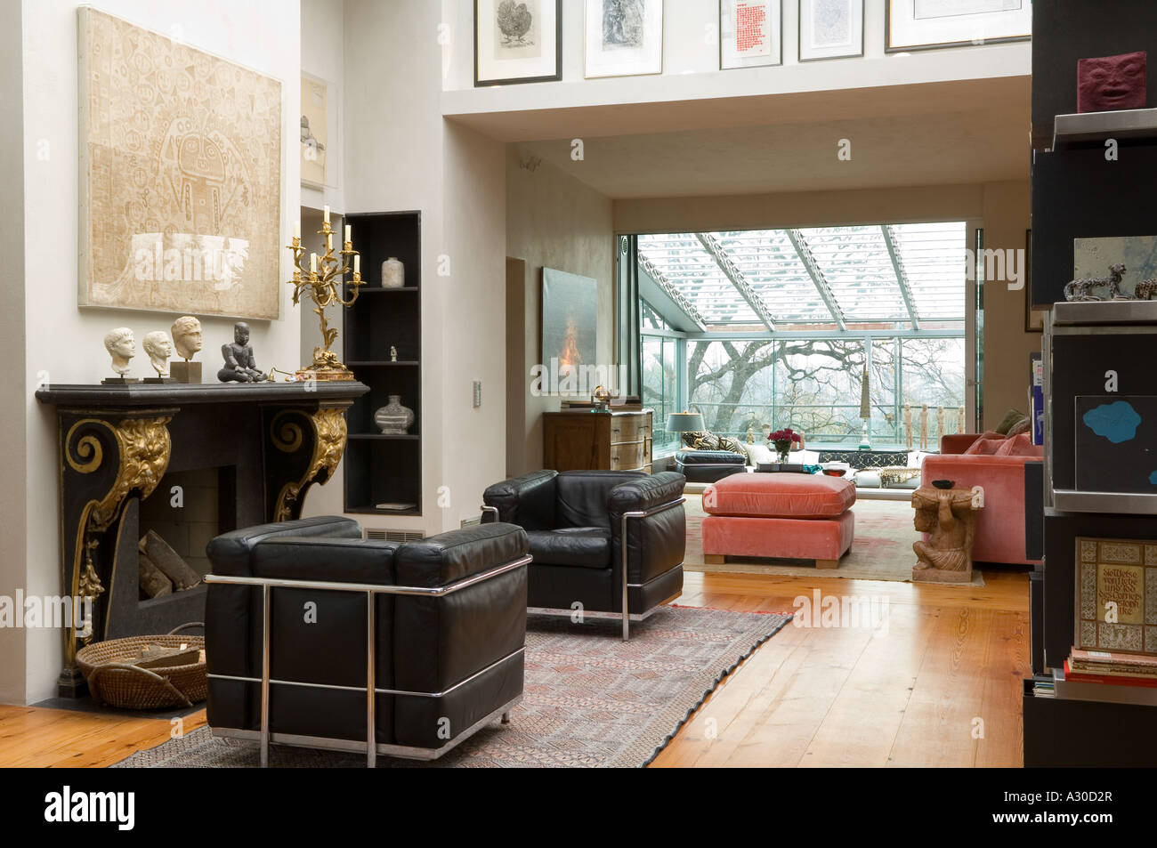 Living room with matching pair of black leather arm chairs ...