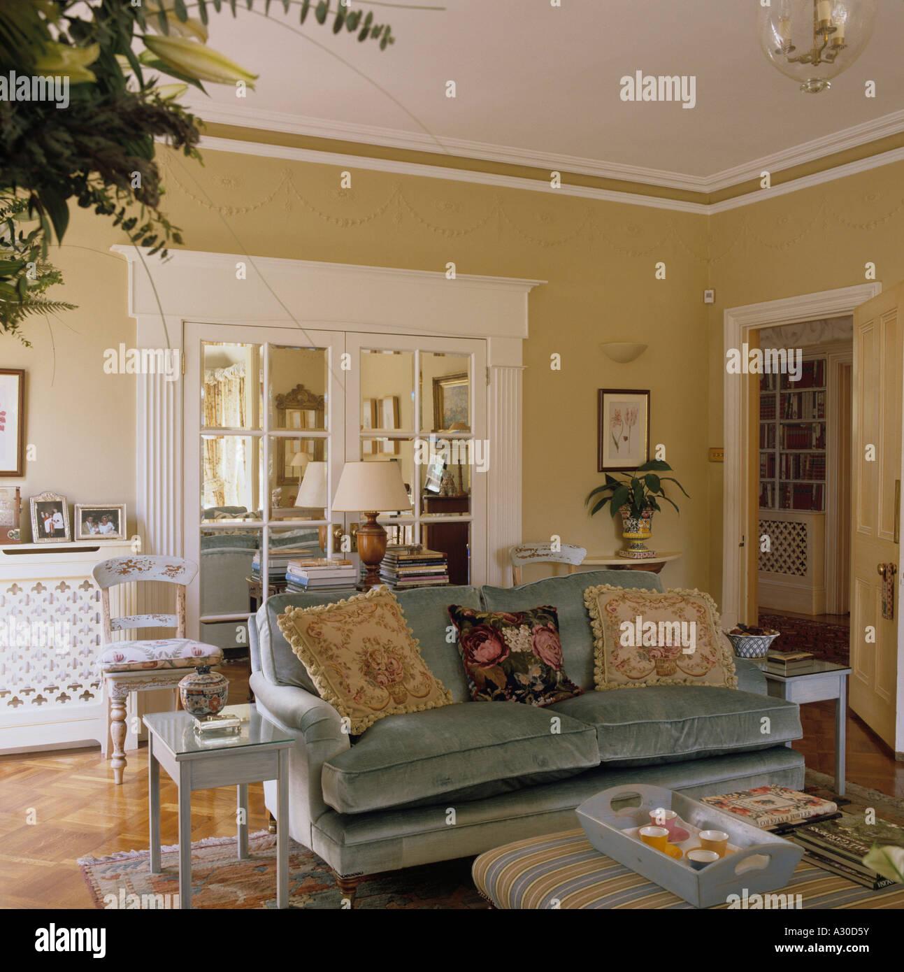 Living room with velvet sofa and mirror panelled door & Living room with velvet sofa and mirror panelled door Stock Photo ...