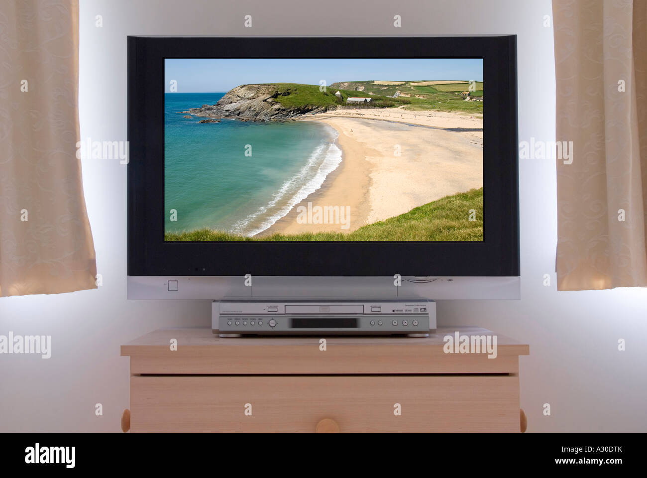 Flat Screen Lcd Tv Television Monitor Fixed To Bedroom Wall Stock Photo Alamy