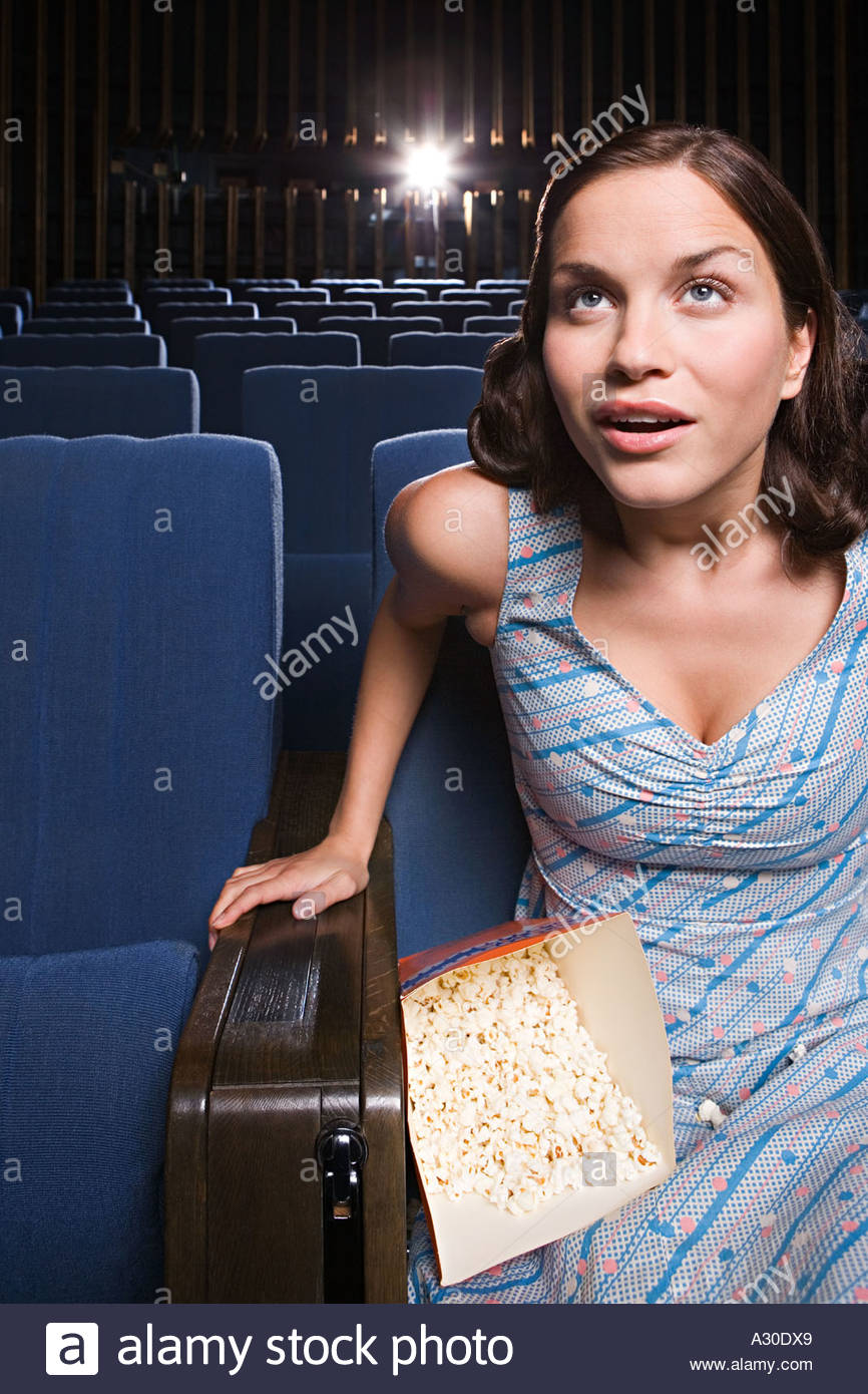 Woman engrossed in movie - Stock Image