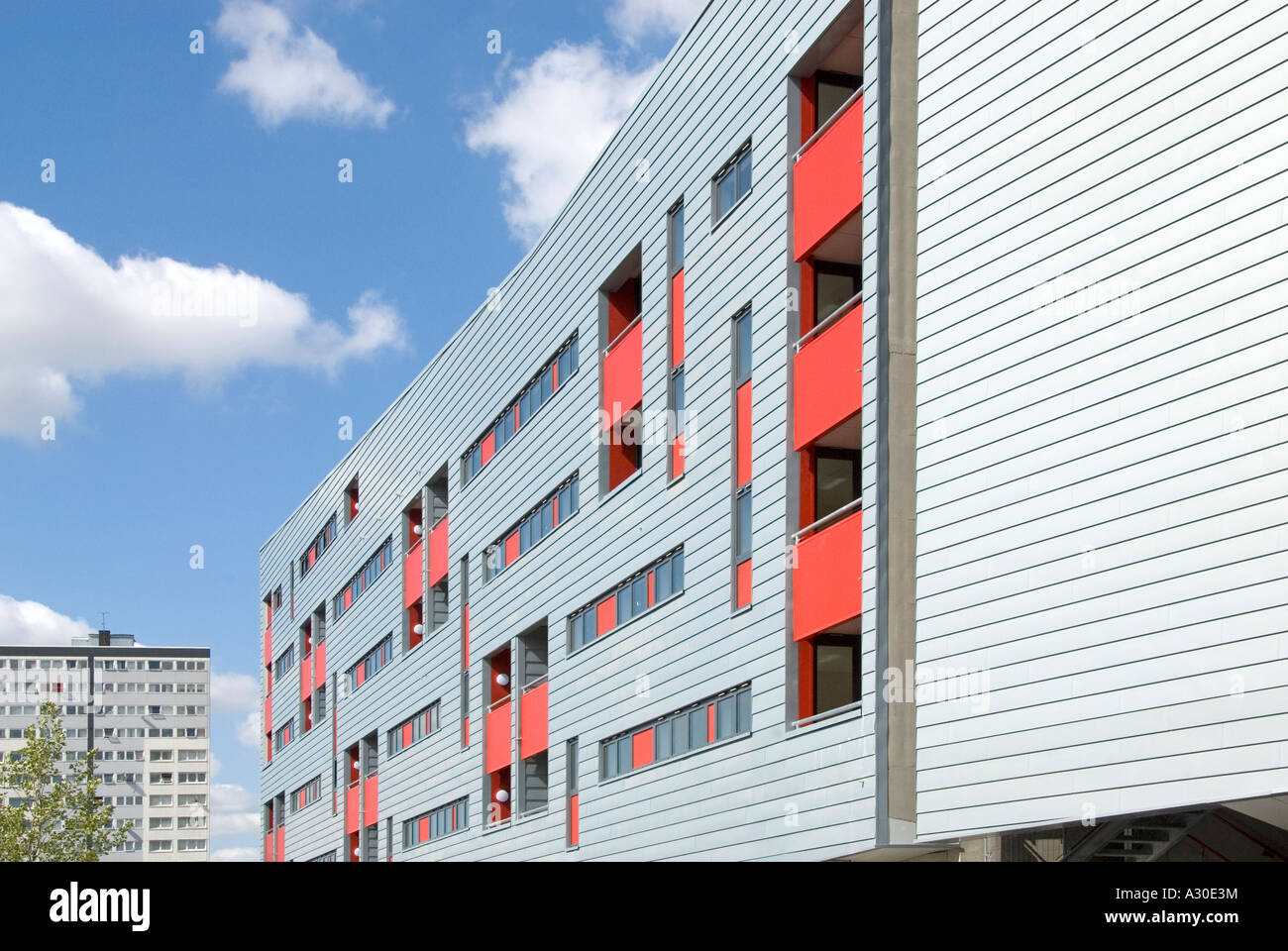 North London development of modern apartment block with traditional high rise block beyond - Stock Image