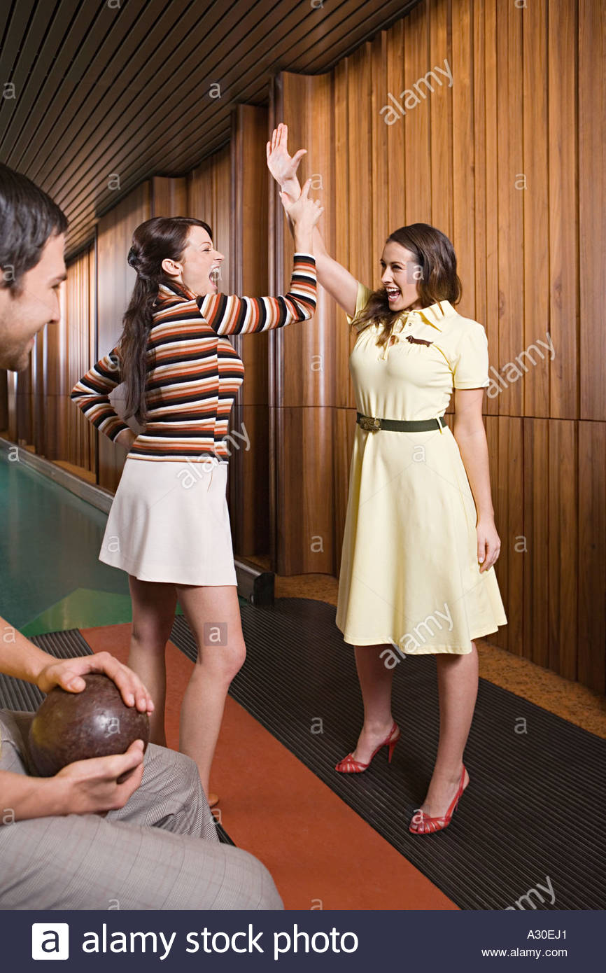 Friends at a bowling alley Stock Photo