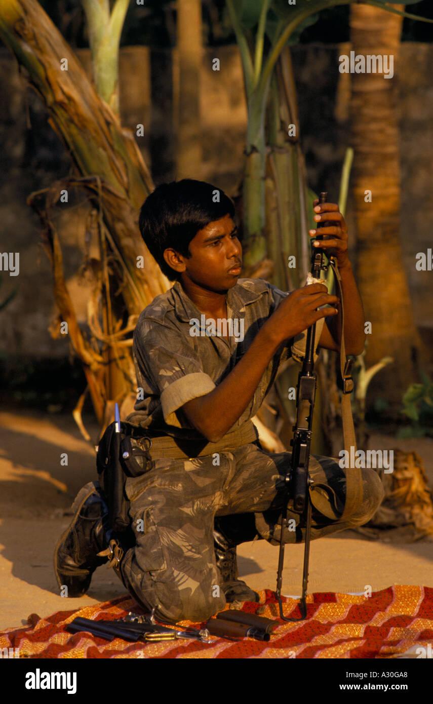 12 year old tamil tiger learning to strip and assemble his ak 47 gun Jaffna Sri Lanka - Stock Image