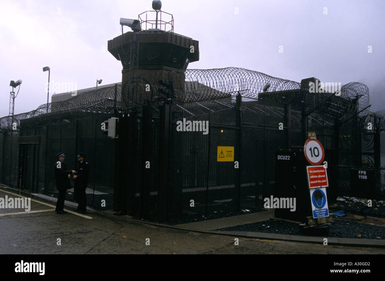 Guards at the security fence around Faslane Naval Base home of Trident Nuclear submarine - Stock Image
