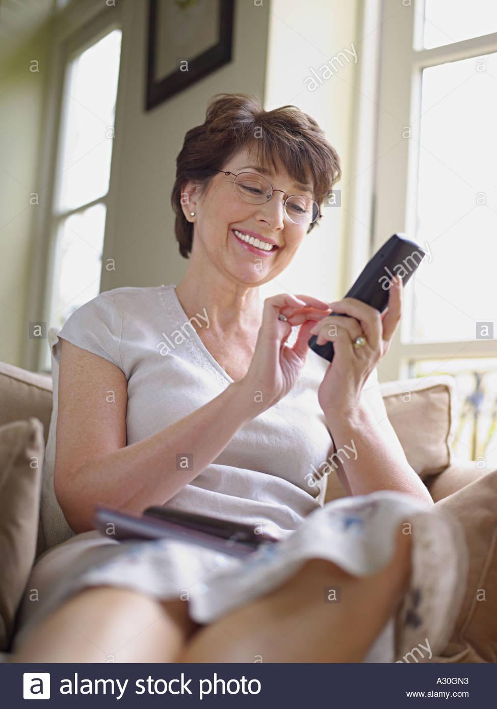 Woman making telephone call - Stock Image