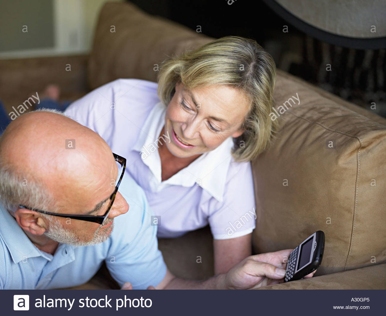 Couple with handheld computer - Stock Image
