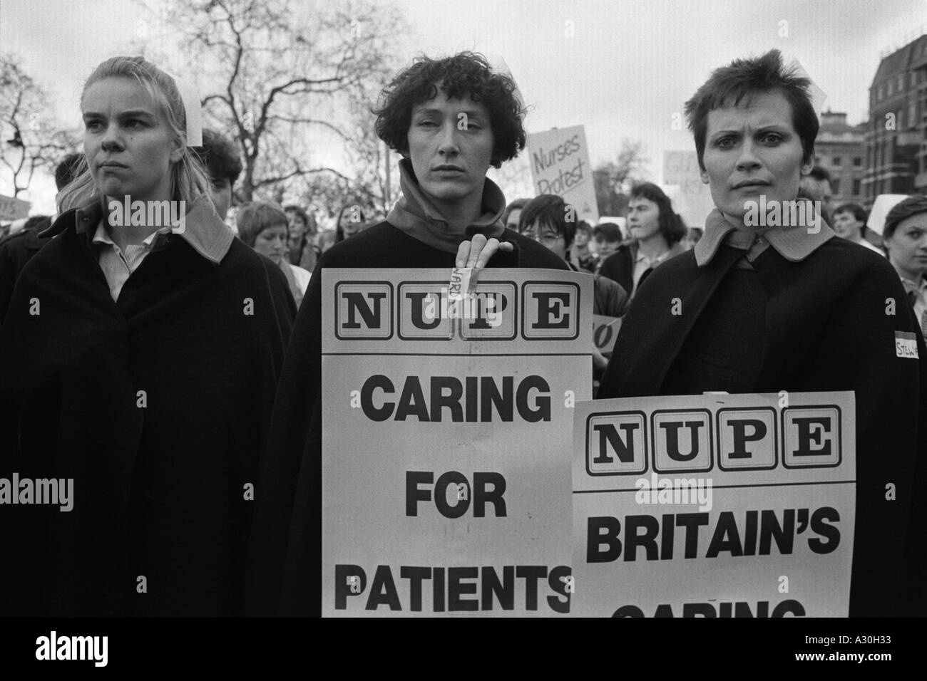 Nurses from London Hospitals staging a one day strike protest in Whitehall - Stock Image
