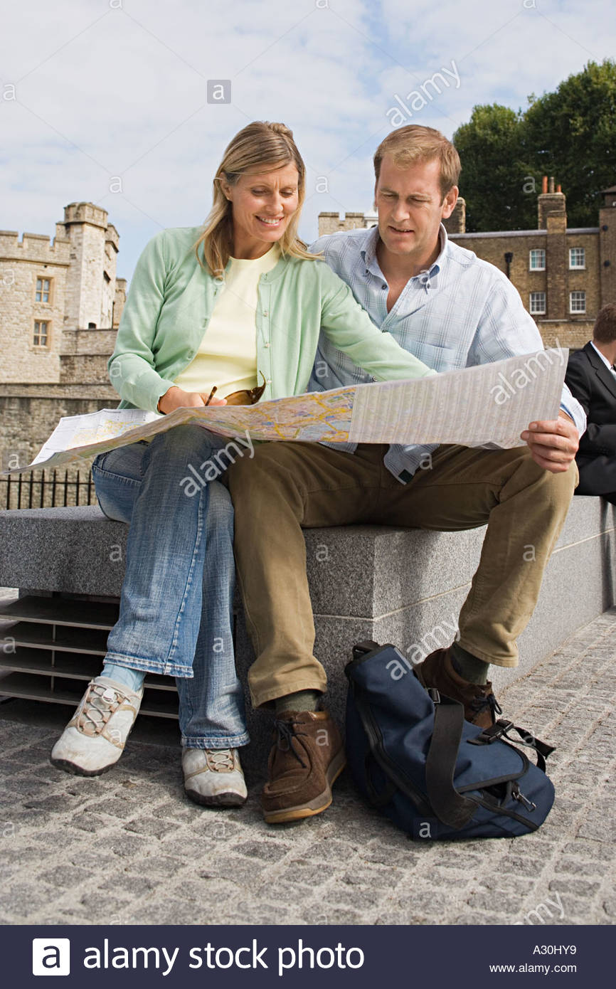 Couple consulting map - Stock Image