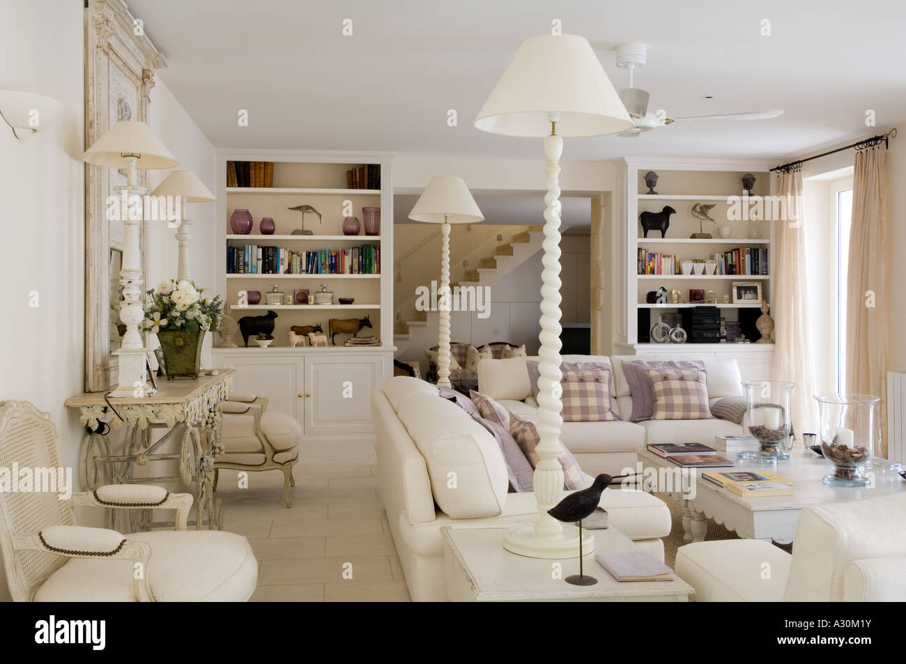 White living room with matching bookcases and lamps Stock Photo ...