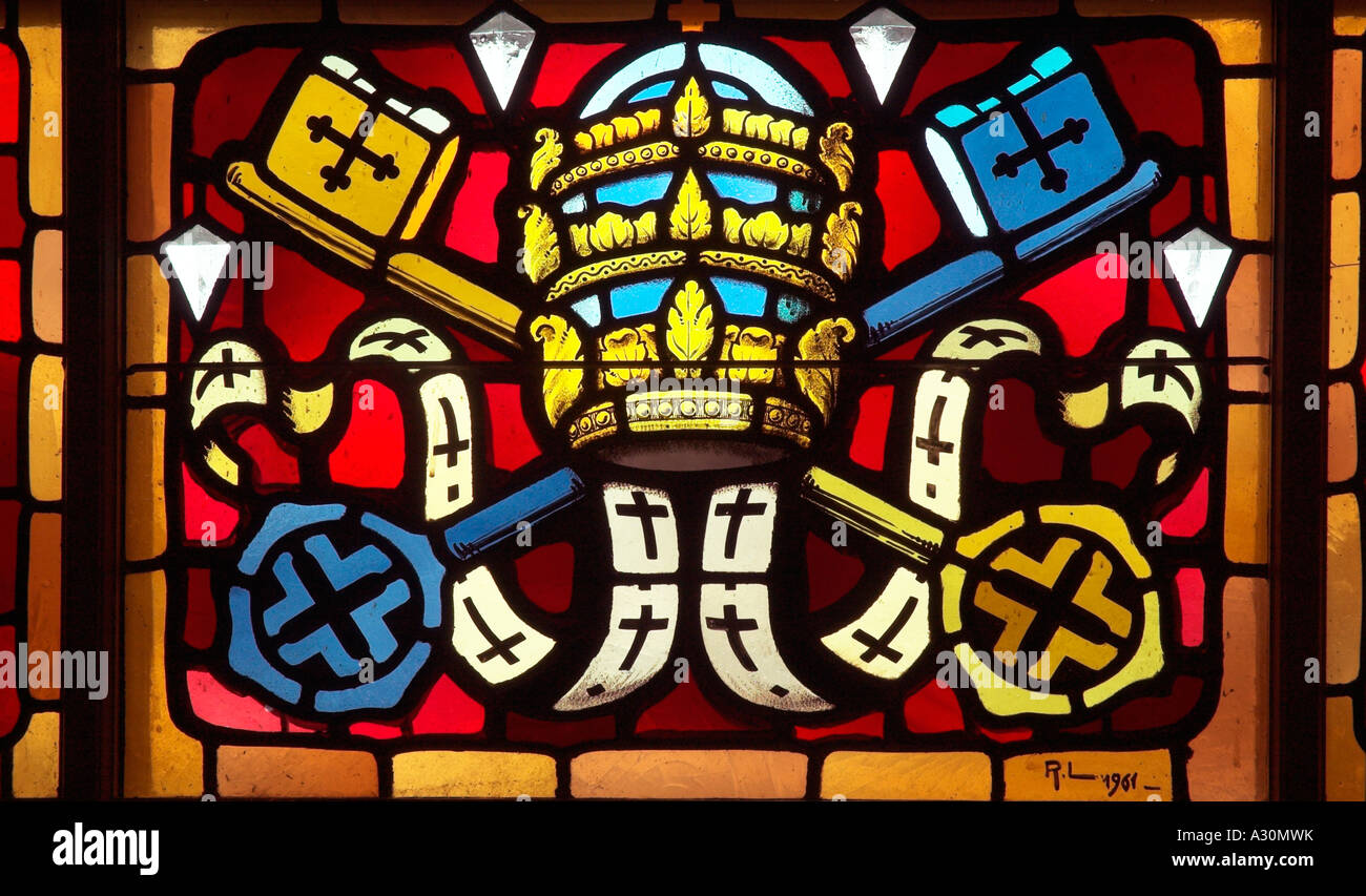 A stained glass window with a crossed keys motif  in the cathedral of Sherbrooke in Quebec Canada - Stock Image