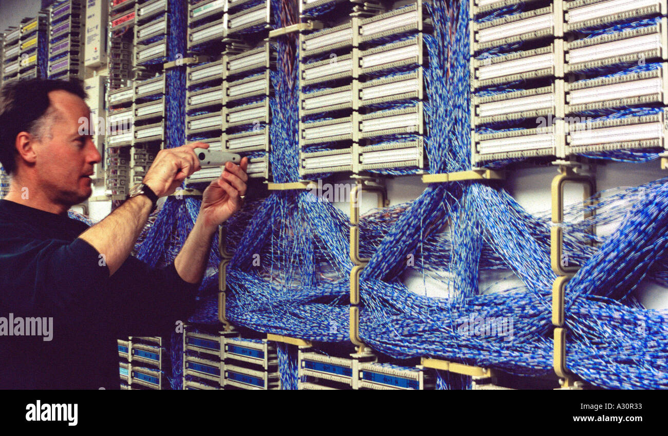 Technicien working on main distribution frame telephone system Stock ...
