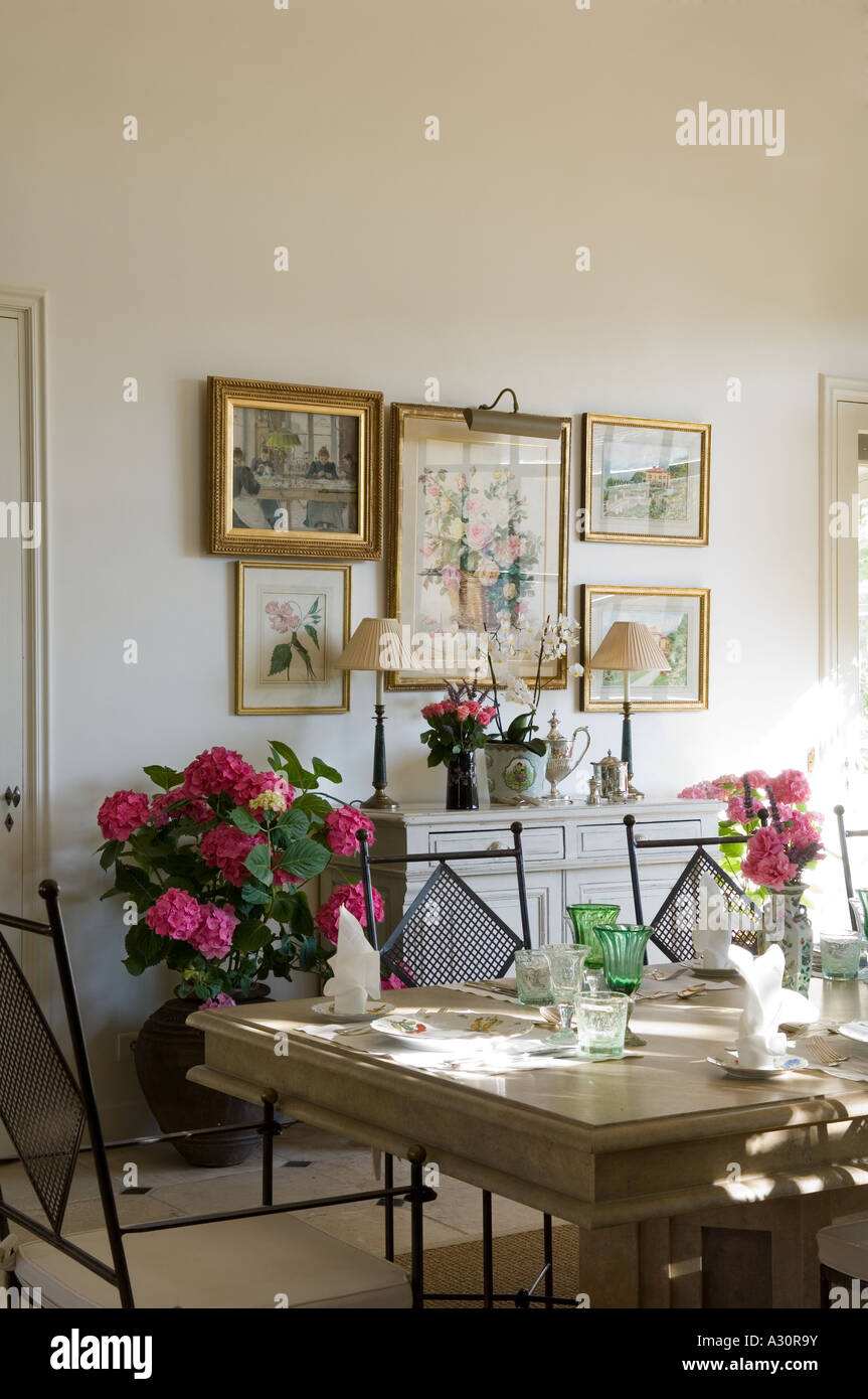 dining place settings. Dining Table With Place Settings And Artwork Display On Wall