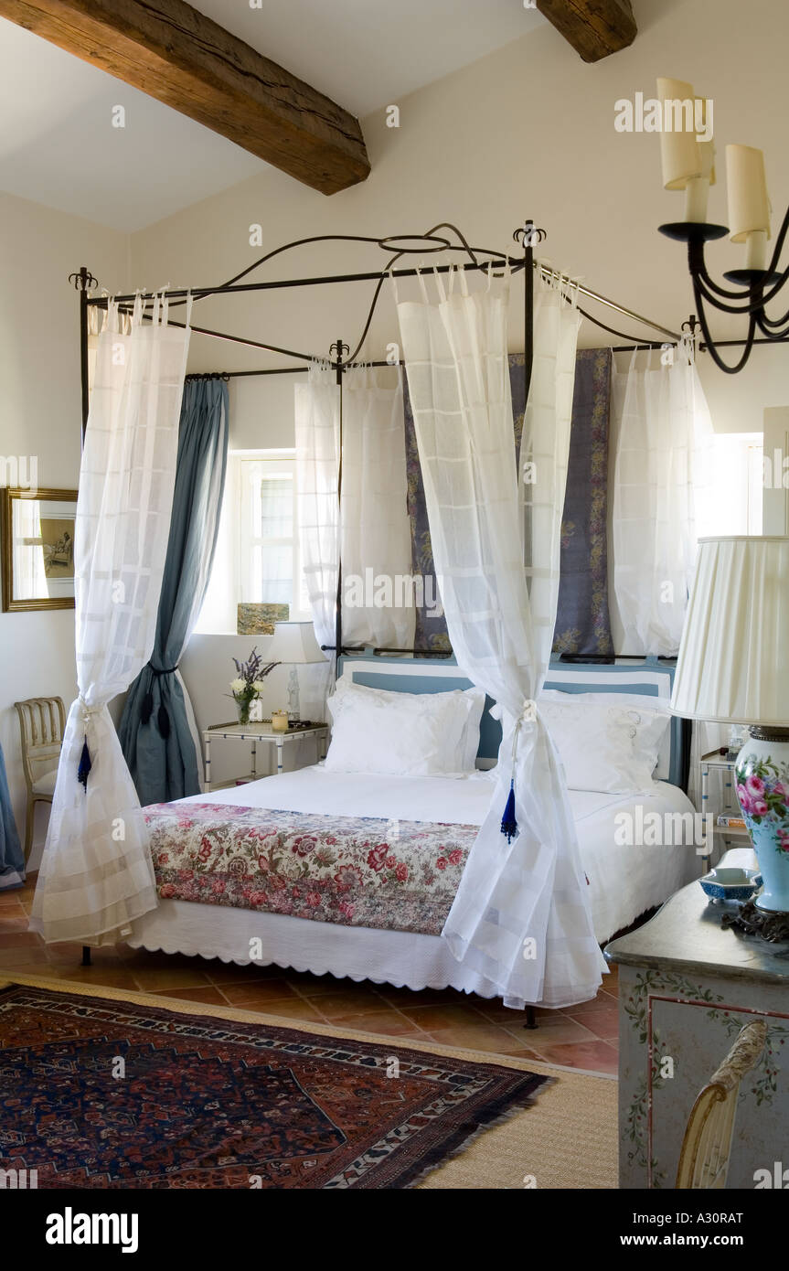 Fourposter bed in bedroom with beamed ceiling in a traditional Provençal house Stock Photo
