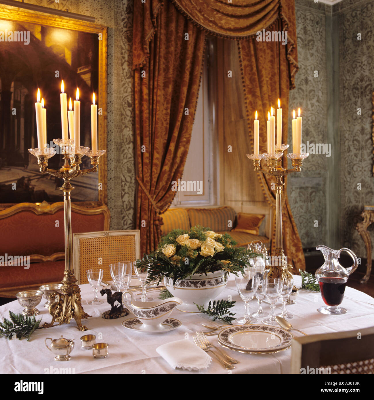 Set dinner table with candle light in a roman palazzo stock photo set dinner table with candle light in a roman palazzo aloadofball Images