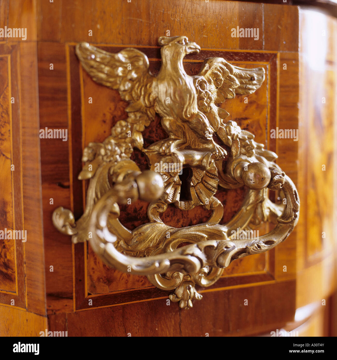 bronze gilt handle on antique writing desk with drawers - Stock Image