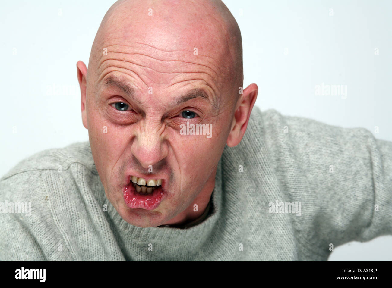 Bald man in a rage at camera - Stock Image