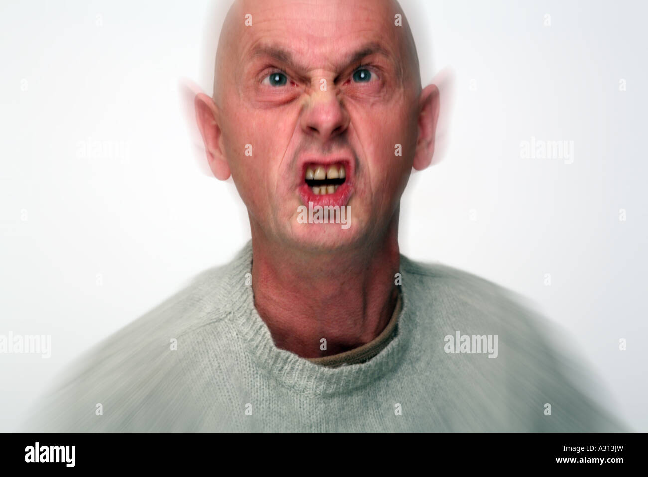 action image of a bald man in a rage - Stock Image
