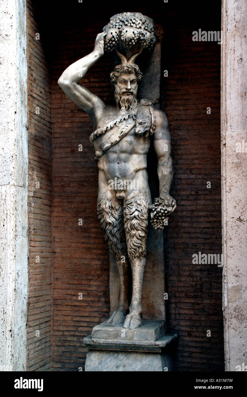 Figure of a Satyr Half Man Half Goat standing in an alcove in the courtyard of the Museo Capitolini Rome Italy - Stock Image