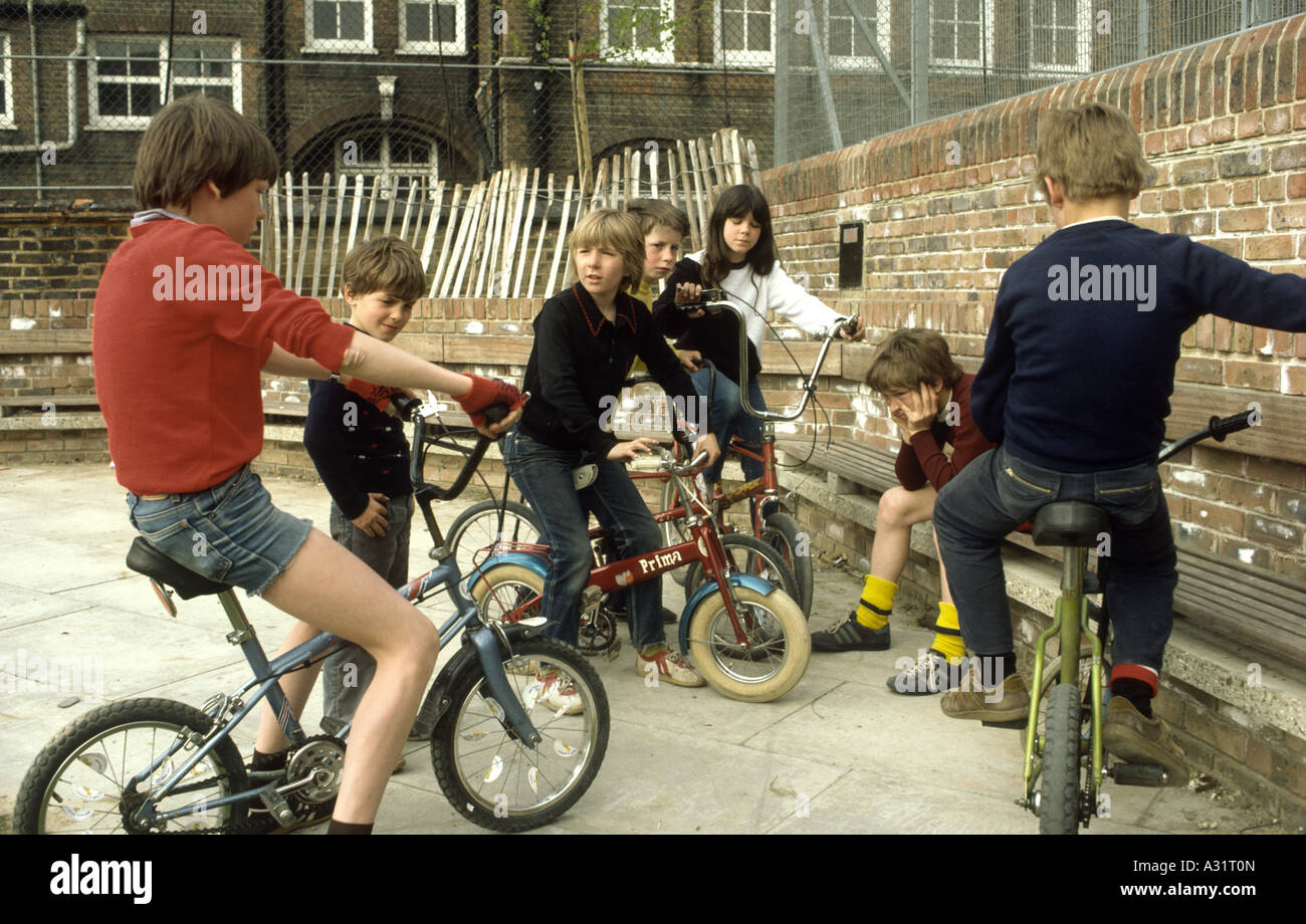 Historical image of young boys on bikes in the seventies - Stock Image