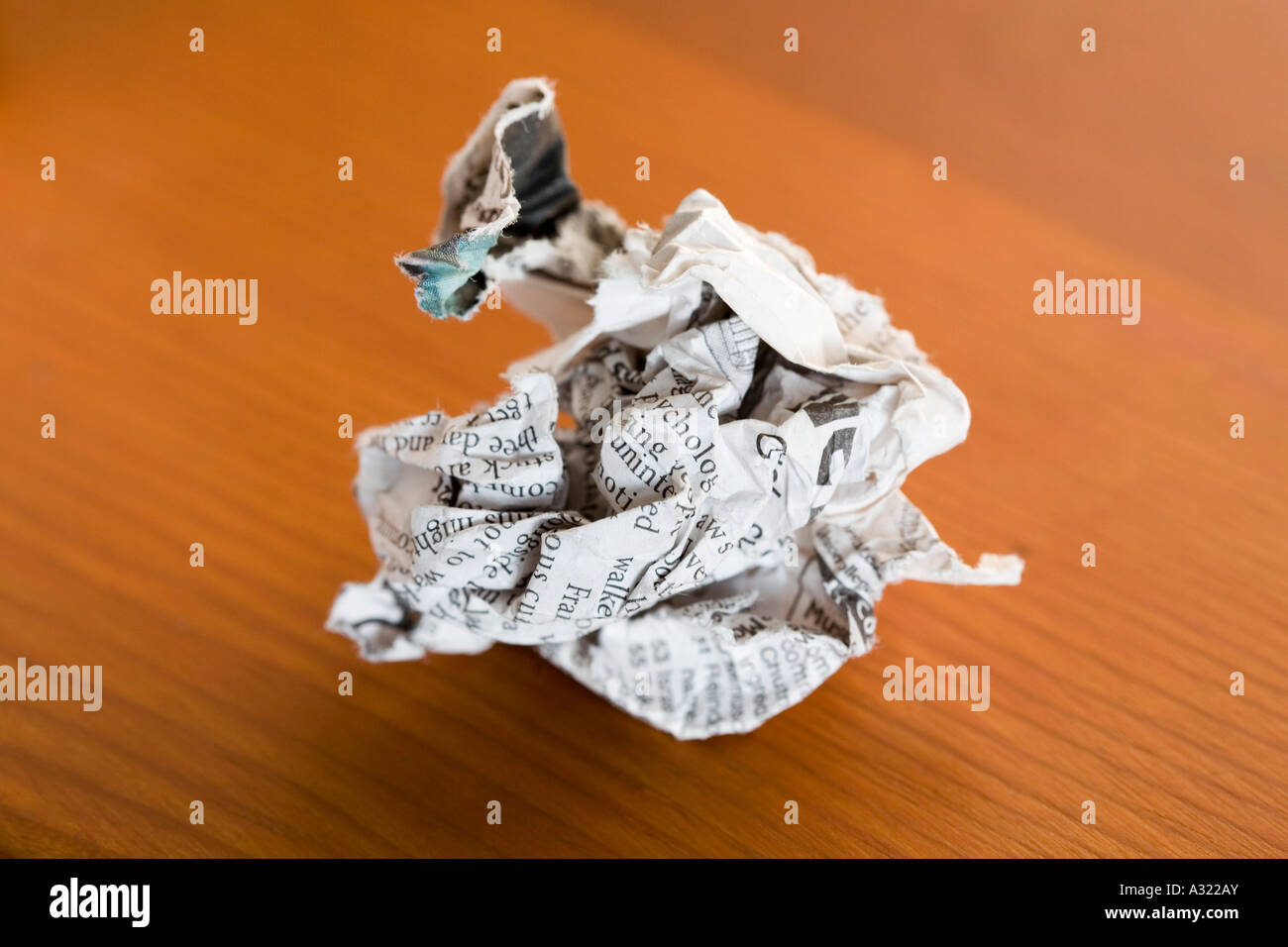 Crumpled newspaper on a table - Stock Image