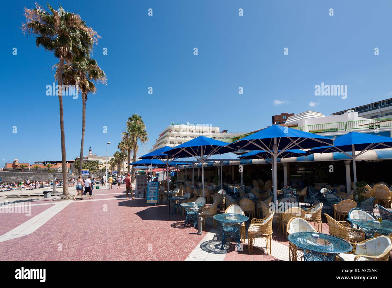 Beachfront cafes, Playa de la Pinta, Costa Adeje, Playa de las Americas, Tenerife, Canary Islands, Spain - Stock Image