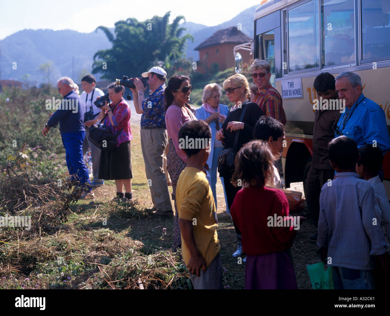 Effect of affluent tourism on children begging in developing country Nepal Asia - Stock Image