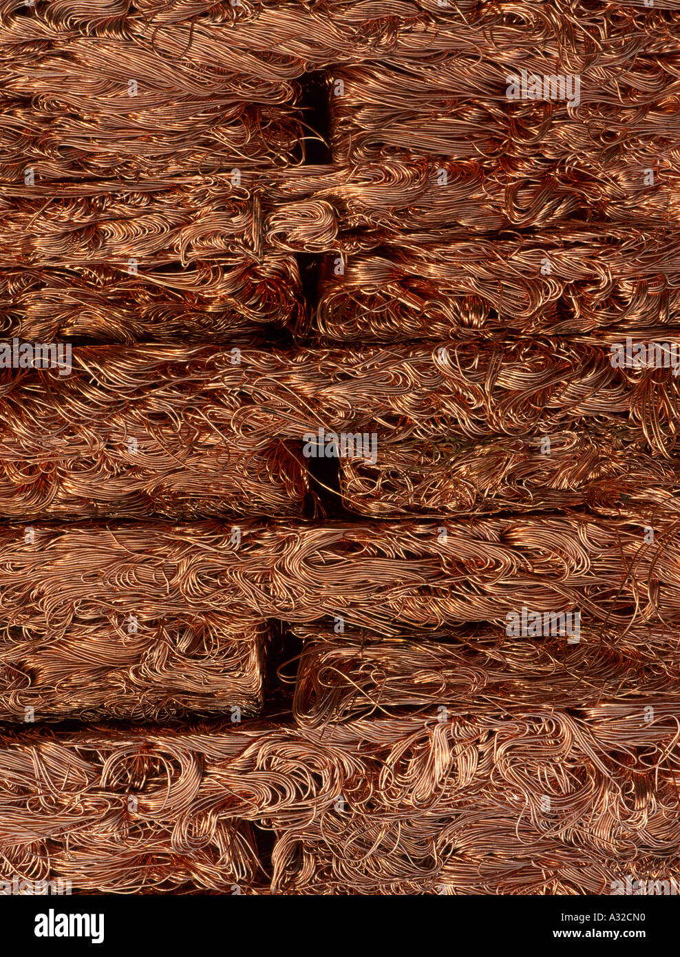 Copper wire compressed prior to recycling North Wales UK Stock Photo ...