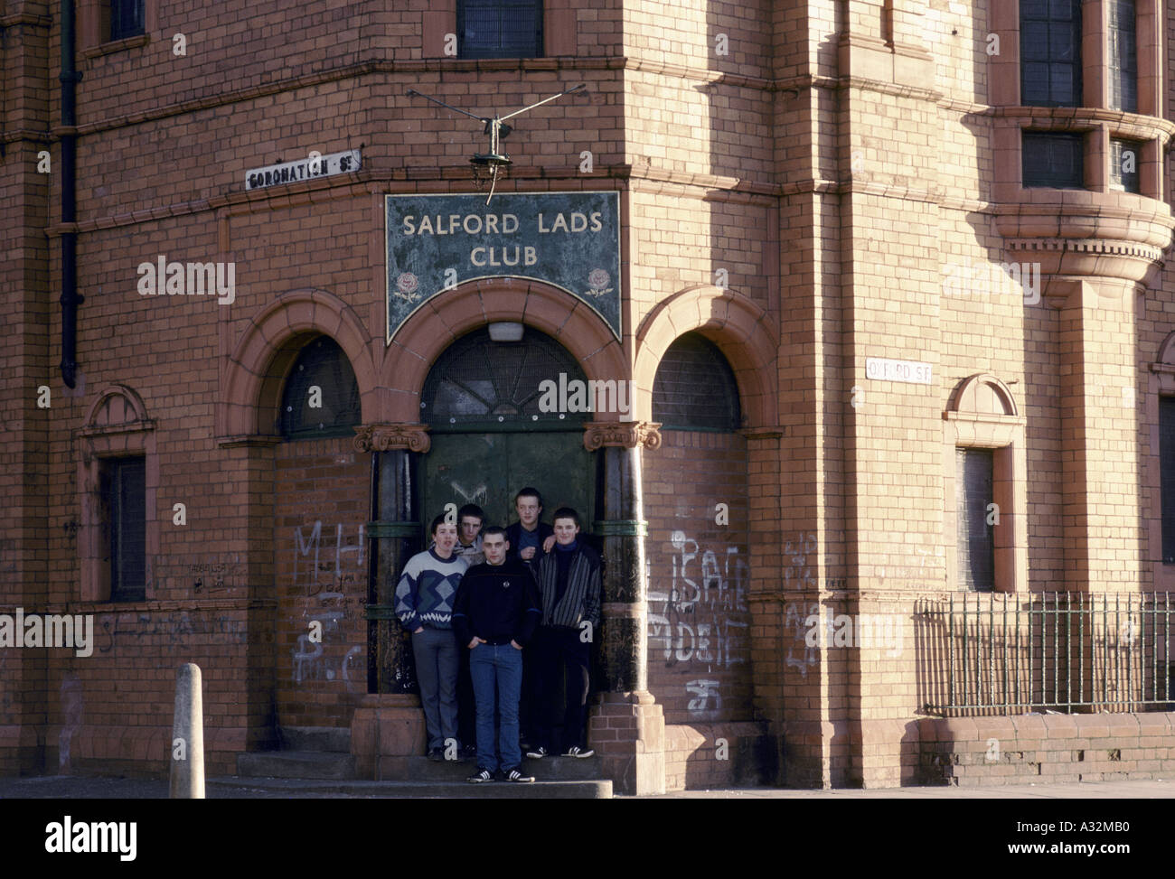 youths in front of the door of the salford lads club salford Stock Photo